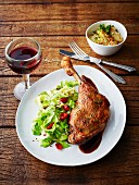 Glazed goose leg with pointed cabbage, chilli pepper, rose hip sauce and a side of potatoes