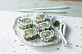 Uramaki sushi with green fish roe and fish