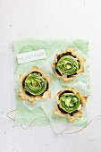 Puff pastry bowls filled with asparagus and black pudding