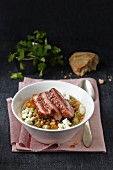 Lentil stew with carrots, celery, feta cheese and duck breast