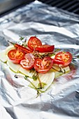 Cherry tomatoes and fennel on aluminium foil