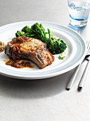 Pork chops with onion sauce and broccoli