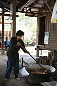 Coconut sugar being made, Thailand