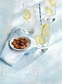 Gin and tonic and almonds