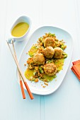 Crab cakes on a bed of red lentils with curry sauce