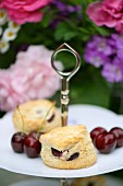 Scones with cherries on a cake stand