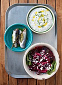Greek mezze: fish, yoghurt and beetroot salad