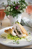 Thyme-stuffed chicken breast on a bed of creamy leek