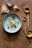 Ginger and apple wontons in coconut water