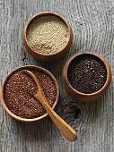 Various types of quinoa in wooden bowls