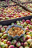 Swedish apple cake on top of a crate of apples