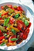 Panzanella with roasted peppers, tomatoes, olives and fresh herbs