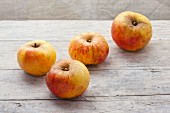 For organic Jakob Lebel apples on a wooden surface