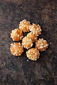 Chouquettes (mini French profiteroles) with sugar nibs