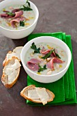 White bean soup with smoked duck breast and parsley