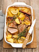 Pork loin with honey, lemons, thyme and potatoes