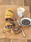 Poppyseed and the yeast roulade with icing and orange zest