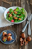Lamb's lettuce salad with chestnuts wrapped in bacon, amarettini and raspberries