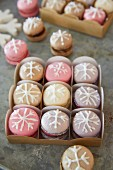 Macaroons iced with snowflakes in a gift box