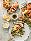 Grilled bread topped with prawns, cress and egg