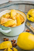 Quinces in a pot, chopped