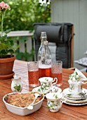 Heart-shaped fruit pie and drinks on garden table