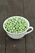 A cup of frozen green peas