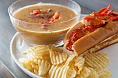 Lobster soup with a lobster roll and potato crisps