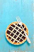 Tartlet with plum jam and a lattice topping