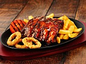 Glazed ribs with chips and onion rings