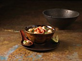 A bowl of Tom Yum soup with prawns, chillis and lime (Thailand)