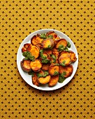 Roast sweet potatoes with a sea salt crust served with mojo verde