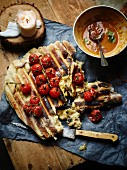 Grilled unleavened bread with cherry tomatoes