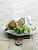 A salad of grilled scallops wrapped in courgette