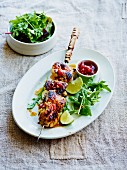 Lime chicken skewers with tomato and chilli chutney and a side salad