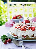 A strawberry cake with cream and white chocolate