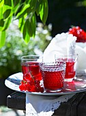 Redcurrant lemonade on a table outside