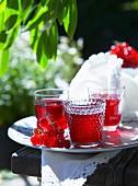 Redcurrant lemonade on a table outside