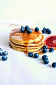 Buttermilk pancakes with maple syrup, blueberries and blood oranges