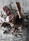 Broken dark chocolate with cocoa beans