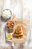 Baked salmon with avocado and tomato salsa and rice