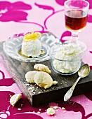 Lemon cream with lemon cookies on a wooden board