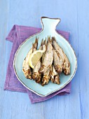 Smoked sprats with lemon