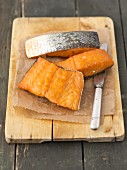 Hot-smoked salmon on a chopping board
