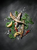 Grilled sardines with seaweed, lemons, chilli and sea salt