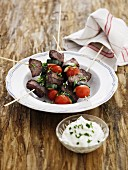 Fillet skewers with courgettes and tomatoes