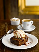 A brownie with vanilla ice cream and espresso in a pub