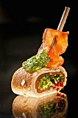 A crepe roll with smoked salmon, lettuce and grilled ham