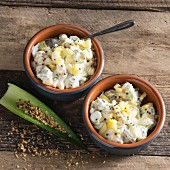 Fruity pineapple coconut raita with spring onions
