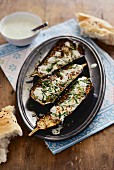 Oven-roasted aubergines with sesame seeds, honey and mint yoghurt (Arabia)